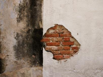 Natural brickwork chip off an alleyway