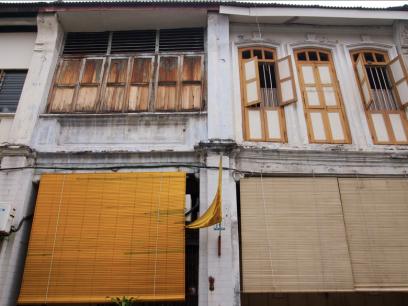 Pre-war shophouses opposite 1881 Chong Tian Hotel