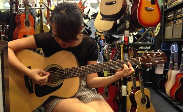 Testing out the Takamine at Davis Guitar