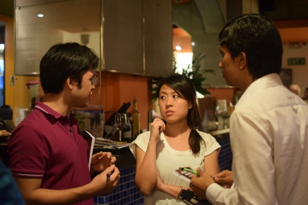 With fellow writers Miguel Vicente Locsin and Tharindu Vishwanath at the launch of the Singapore Writer's Group's first anthology ROJAK. The Earshot Café, The Arts House, 2014.